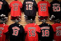 Boston Red Sox merchandise hangs on a wall for sale in a shop near Fenway Park in Boston, Massachusetts, USA.
