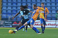 Wycombe Wanderers Marcus Bean is tackled by Mansfield Town's Nicky Hunt during the Sky Bet League 2 match between Mansfield Town and Wycombe Wanderers at the One Call Stadium, Mansfield, England on 31 October 2015. Photo by Garry Griffiths.