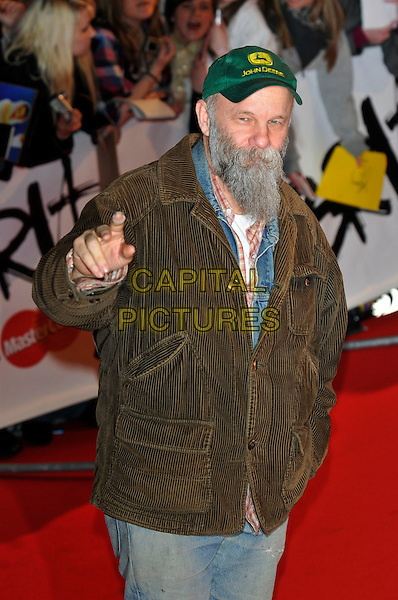 SEASICK STEVE .Arrivals - 2009 Brit Awards, Earls Court, London, England, February 18th 2009..brits half length beard green jacket brown hat cap scruffy facial hair hand waving gesture .CAP/PL.©Phil Loftus/Capital Pictures