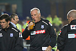 Home team manager Ronnie Moore drinking from a bottle as he makes his way to the dugout at Prenton Park before Tranmere Rovers host Stoke City in a Capital One Cup third round match. The Capital One cup was formerly known as the League Cup and was competed for by all 92 English Premier League and Football League clubs. Visitors Stoke City won the match 2-0, watched by a crowd of 5,559 spectators.