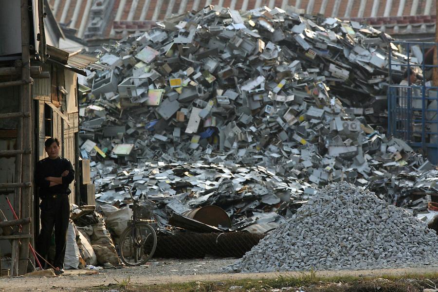 A junk yard boss keeps watch over his e-trash in Nanyang near Guiyu in Guangzhou province.