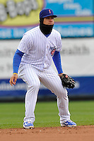 Javy Baez #12 of the Iowa Cubs takes his stance at shortstop against the Omaha Storm Chasers at Principal Park on May 1, 2014 in Des Moines, Iowa. The Cubs  beat Storm Chasers 1-0.   (Dennis Hubbard/Four Seam Images)