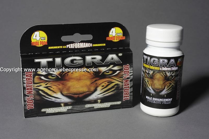 Montreal (Qc) CANADA - June 2 2012 -  TIGRA  : 100 % natural, 100 % made in quebec male enhancement potency pill -  4 pieces trial pack (L)<br /> 24 pieces bottle (R) english label.