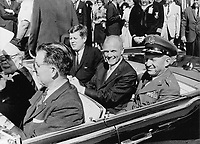 Johnson Space Center - 1962 File - President John F. Kennedy (left), John Glenn and General Leighton I. Davis ride together during a parade in Cocoa Beach, Florida after Glenn's historic first U.S. human orbital spacefight.