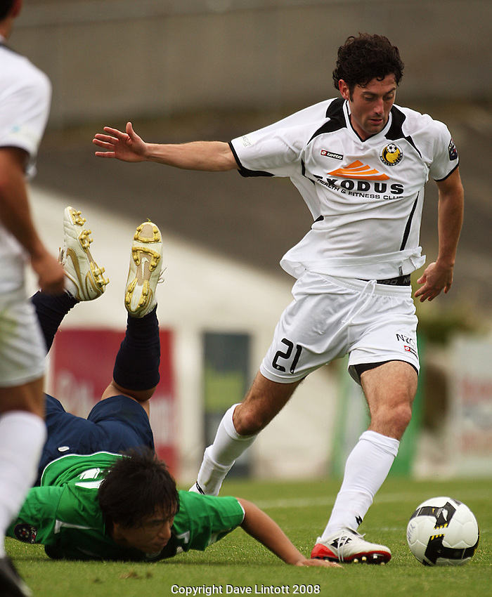 Manawatu's Park Sung-Bae hits the deck after a challenge from Brian Little during the NZFC Championship Round Two match between Youngheart Manawatu and Team Wellington at Memorial Park, Palmerston North, NewZealand on Saturday, 15 November 2008. Photo: Dave Lintott / lintottphoto.co.nz