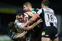 Picture by Alex Whitehead/SWpix.com - 20/02/2014 - Rugby League - First Utility Super League - Wakefield Trinity Wildcats v Bradford Bulls - Rapid Solicitors Stadium, Wakefield, England - Wakefield's Daniel Smith is tackled by Bradford's Adam Sidlow, Nick Scruton and James Donaldson.
