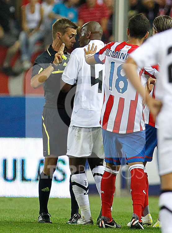 Vitoria S.C Guimaraes' Joao Paulo have words with the referee Clement Turpin (l) during Europa League match.August 18 ,2011. (ALTERPHOTOS/Acero)