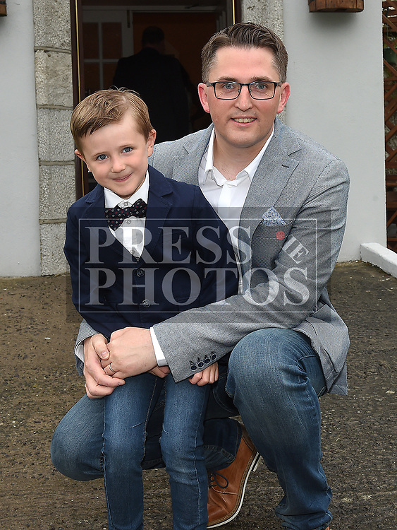 Joe Murray who received first holy communion in St Joseph's church Mell, pictured with dad Robert. Photo:Colin Bell/pressphotos.ie