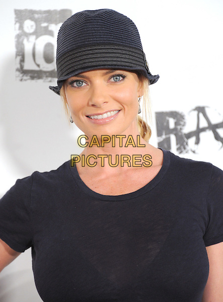 Jaime Pressly.attends the official launch party for 'Rage' in ChinaTown, Los Angeles, California, USA, September 30th 2011..portrait headshot  smiling  black t-shirt hat .CAP/RKE/DVS.©DVS/RockinExposures/Capital Pictures.
