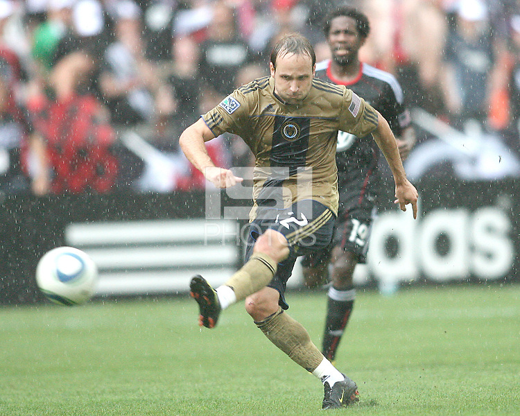 Clyde Simms #19 of D.C. United watches Justin Mapp #22 of the Philadelphia Union take a shot during an MLS match at RFK Stadium on August 22 2010, in Washington DC. United won 2-0.