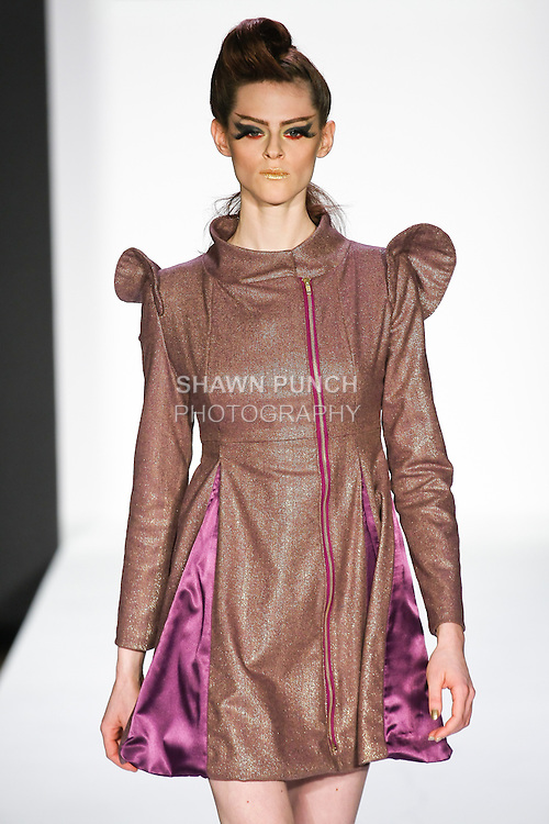 """Model walks runway in a Sachika Fall 2011 """"The Awakening Of A Swan"""" collection, at the Style 360 Fall 2011 fashion show, during New York Fashion Week."""