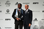 16 January 2014: Andre Blake, with commissioner Don Garber (right), was select with the first overall pick of the draft by the Philadelphia Union. The 2014 Major League Soccer SuperDraft was held at the NSCAA Annual Convention in the Pennsylvania Convention Center in Philadelphia, Pennsylvania.