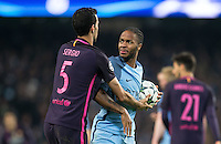 Kevin De Bruyne of Manchester City holds the ball away from Sergio Busquets of Barcelona during the UEFA Champions League match between Manchester City and Barcelona at the Etihad Stadium, Manchester, England on 1 November 2016. Photo by Andy Rowland / PRiME Media Images.