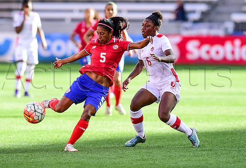 19 FEB 2016: Costa Rica Defender Diana Sáenz (5) looks to pass under pressure from Canada Forward Deanne Rose Scarborough (6) during the Women's Olympic qualifying soccer match between Canada and Costa Rica at BBVA Compass Stadium in Houston, Texas.