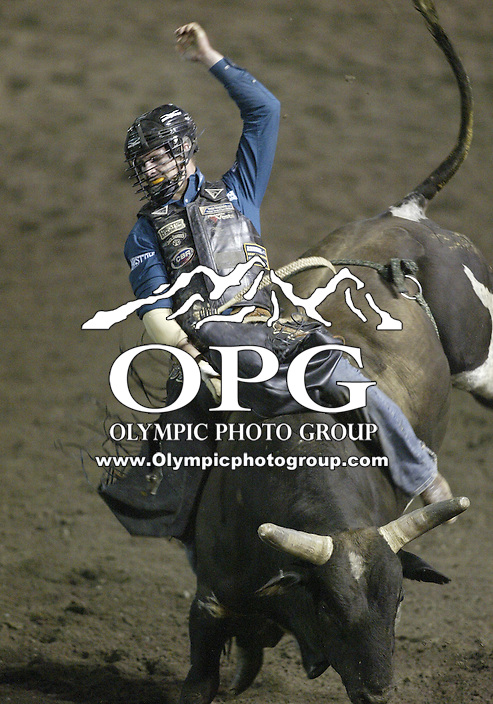 28 Aug 2009:  Jarrod Craig riding the bull Cool Cash was not able to score a time in the Bull Riding competition at the Kitsap County Wrangler Million Dollar PRCA Pro Rodeo Tour in Bremerton, Washington.