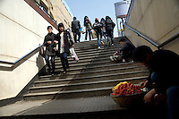 Fruit sellers display their wares on the stairway of a pedestrian underpass in the central Xinjeikou shopping district in Nanjing, China.