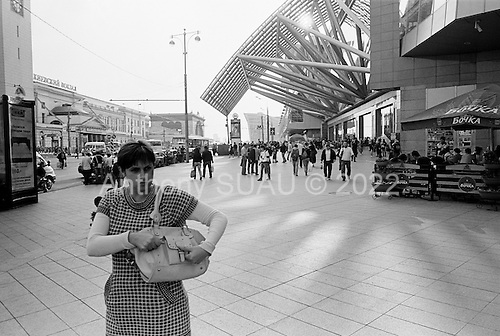 Moscow, Russia.September 14, 2009..Well dressed families, businessmen and women move around the new Evropeisky shopping and entertainment center located across the street from Kievsky Train Station. ........