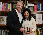CORAL GABLES, FL - August 17: Steve Moss and author Dr. Carmen Harra signs copies of her book 'The Karma Queens' Guide to Relationships' at Books and Books-Gables on Monday August 17, 2015 in Voral Gables, Florida.  ( Photo by Johnny Louis / jlnphotography.com )
