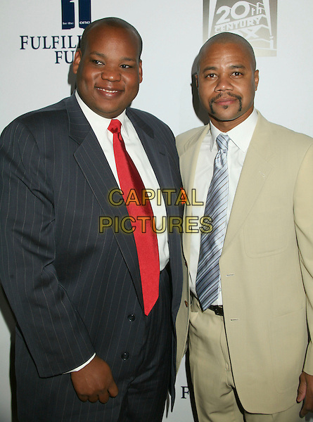 "RODNEY BEARD & CUBA GOODING JR..Annual ""Stars 2006"" Benefit Gala hosted by the Fulfillment Fund held at the Beverly Hilton Hotel, Beverly Hills, California, USA..October 16th, 2006.Ref: ADM/BP.half length beige grey gray pinstripe suit jacket.www.capitalpictures.com.sales@capitalpictures.com.©Byron Purvis/AdMedia/Capital Pictures."