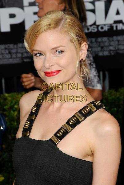 """JAIME KING.The Hollywood Premiere """"Prince Of Persia: The Sands Of Time"""" at Grauman's Chinese Theatre in Hollywood, California, USA..May 17th, 2010.headshot portrait red lipstick smiling jamie hair up make-up metal embellished black gold straps jamie .CAP/ROT.©Lee Roth/Capital Pictures"""