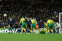 1st December 2019; Carrow Road, Norwich, Norfolk, England, English Premier League Football, Norwich versus Arsenal; Pierre-Emerick Aubameyang of Arsenal lines up a shot as he scores for 2-2 with 2 balls on the pitch - Strictly Editorial Use Only. No use with unauthorized audio, video, data, fixture lists, club/league logos or 'live' services. Online in-match use limited to 120 images, no video emulation. No use in betting, games or single club/league/player publications