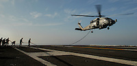 "071103-N-7981E-407 Pacific Ocean (November 3, 2007)- Members of Helicopter Visit Board Search and Seizure (HVBSS) Team 1 maintain control of their line after fast-roping from an SH-60F Seahawk assigned to ""Golden Falcons"" Helicopter Anti-Submarine Squadron (HS) 2 on the flight deck of Nimitz-class aircraft carrier USS Abraham Lincoln (CVN 72). HVBSS-1 is the first dedicated HVBSS team to reach operational status and they are currently training aboard Lincoln as part of the ship's scheduled work-up. Lincoln and embarked Carrier Air Wing (CVW) 2 are underway off the coast of Southern California participating in Composite Training Unit Exercise (COMPTUEX). U.S. Navy photo by Mass Communication Specialist 3rd Class James R. Evans (RELEASED)"