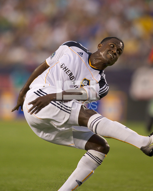 Los Angeles Galaxy forward Edson Buddle (14) follows through on a shot. The New England Revolution defeated LA Galaxy, 2-0, at Gillette Stadium on July 10, 2010.