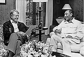 United States President Jimmy Carter, left, and President Anwar al-Sadat of Egypt, right, meet in Dogwood Lodge at Camp David, the presidential retreat near Thurmont, Maryland on September 19, 1978..Credit: White House via CNP