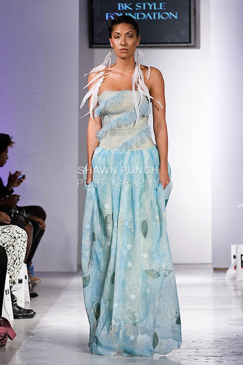 Model walks the runway in an outfit by Lea Mono, from the Lea Mono Couture Spring 2012 fashion show, during BK Fashion Weekend Spring Summer 2012.