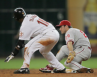 Phillies 2B Chase Utley attempts to tag Astros SS Miguel Tejada on Saturday May 24th at Minute Maid Park in Houston, Texas. Photo by Andrew Woolley / Baseball America....