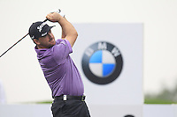 Graeme McDowell (NIR) tees off the 2nd tee during Thursday's Round 1 of the 2014 BMW Masters held at Lake Malaren, Shanghai, China 30th October 2014.<br /> Picture: Eoin Clarke www.golffile.ie