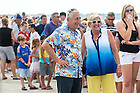 John Hiltz's parents Dan '74MA, '79PhD and Chris watch at the Dayton Air Show.  Two of their three sons attended Notre Dame and the third is a graduate of the U.S. Coast Guard Academy and is currently serving in the Coast Guard.<br /> <br /> Photo by Matt Cashore/University of Notre Dame
