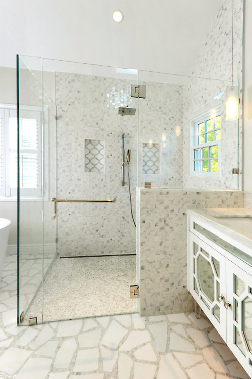 This custom handmade Path mosaic floor is shown in Thassos and Calacatta Tia and was designed by Sara Baldwin for New Ravenna.<br /> -photo courtesy of Kym Maloney Design<br /> <br /> For pricing samples and design help, click here: http://www.newravenna.com/showrooms/
