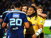 Ma'a Nonu and Conrad Smith shakes hands with the Blues players after the Super Rugby match between the Hurricanes and Blues at FMG Stadium, Palmerston North, New Zealand on Friday, 13 March 2015. Photo: Dave Lintott / lintottphoto.co.nz