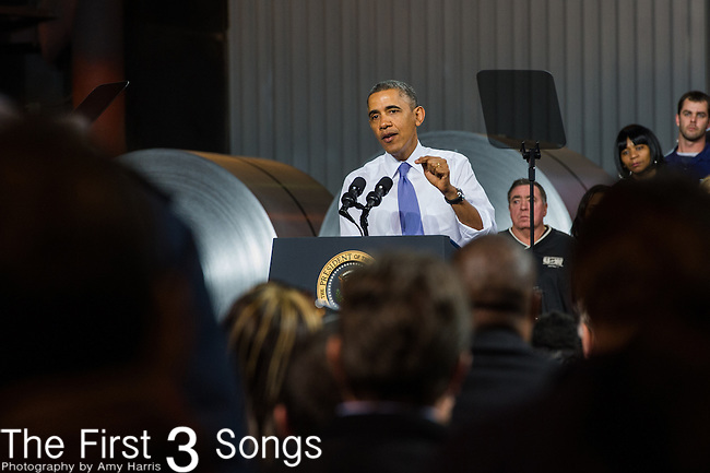 U.S. President Barack Obama speaks to workers at ArcelorMittal, the world's largest steel company, November 14, 2013 in Cleveland, Ohio. The President touched on the topics of the economy and health care