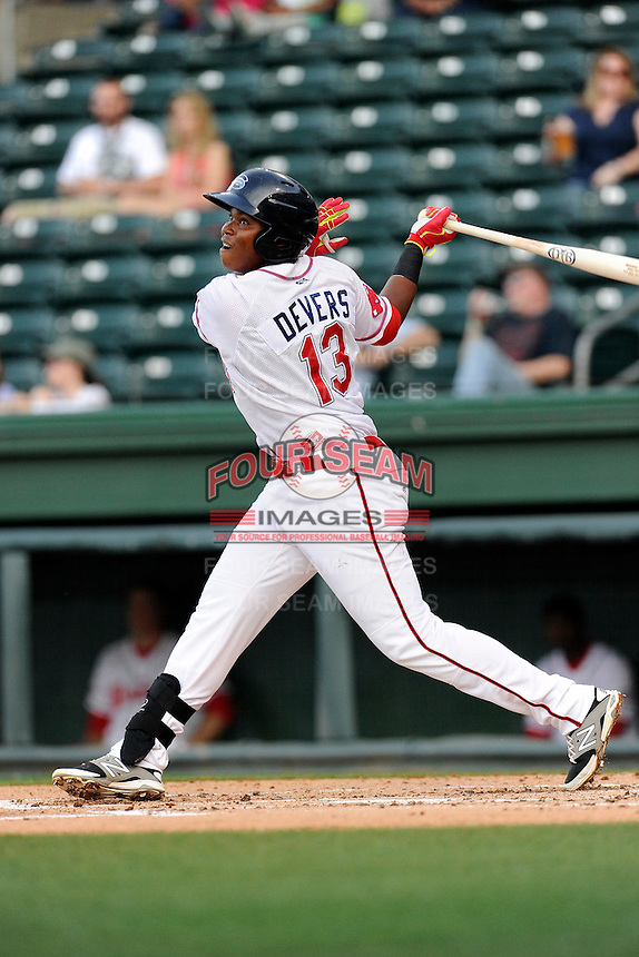 Infielder Rafael Devers (13) of the Greenville Drive bats in a game against the Lexington Legends on Tuesday, April 14, 2015, at Fluor Field at the West End in Greenville, South Carolina. Lexington won, 5-3. (Tom Priddy/Four Seam Images)
