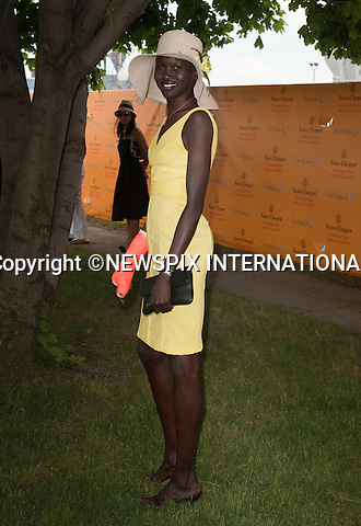 """Alek Wek.Prince Harry.Attends the second annual Veuve Clicquot Manhattan Polo Classic on Governors Island.The Prince plays for the Sentebale team against the Black Watch team in a 4-chukka exhibition match_ Governors Island, New York, USA_30/05/2009.Mandatory Photo Credit: ©Dias/Newspix International..**ALL FEES PAYABLE TO: """"NEWSPIX INTERNATIONAL""""**..PHOTO CREDIT MANDATORY!!: NEWSPIX INTERNATIONAL(Failure to credit will incur a surcharge of 100% of reproduction fees)..IMMEDIATE CONFIRMATION OF USAGE REQUIRED:.Newspix International, 31 Chinnery Hill, Bishop's Stortford, ENGLAND CM23 3PS.Tel:+441279 324672  ; Fax: +441279656877.Mobile:  0777568 1153.e-mail: info@newspixinternational.co.uk"""