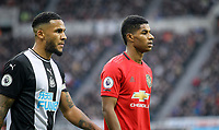 Marcus Rashford of Man Utd & Jamaal Lascelles of Newcastle United  during the Premier League match between Newcastle United and Manchester United at St. James's Park, Newcastle, England on 6 October 2019. Photo by J GILL / PRiME Media Images.
