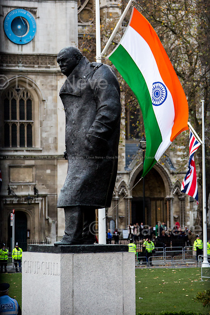 London, 12/11/2015. Today, the Prime Minister of India Narendra Modi (Leader of the Bharatiya Janata Party, BJP; former Chief Minister of Gujarat from 2001 to 2014; actual Member of Parliament from Varanasi) met the British Prime Minister David Cameron at 10 Downing Street during his visit to the UK. After the meeting, the two Prime Ministers went to Parliament Square (cleared from traffic and members of the public) to pay tribute to the Mahatma Gandhi statue and to see the Red Arrows performing a flypast over Westminster. In the meantime, Sikh and Kashmir people protested patrolled by heavy police presence.