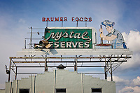 Crystal Preserves sign that suffered major damage due to Hurricane Katrina flooding in Mid-City New Orleans, Louisiana.