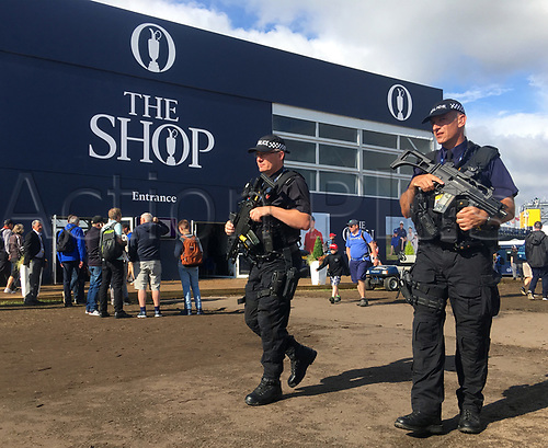 23rd July 2017, Royal Birkdale Golf Club, Southport, England; The 146th Open Golf Championship, fourth round ; Armed Merseyside Police officers on patrol in the tented village