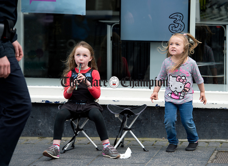 Jaymee and  Kayla Martin of Louth perform on Abbey street, Ennis during Fleadh Cheoil na hEireann. Photograph by John Kelly.
