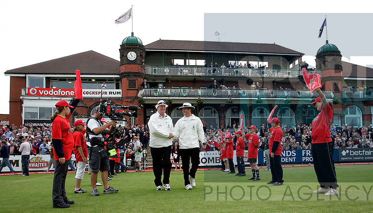 Umpires Darrell Hare (L) and Simon Taufel of Australia walk out to the middle at the start of play