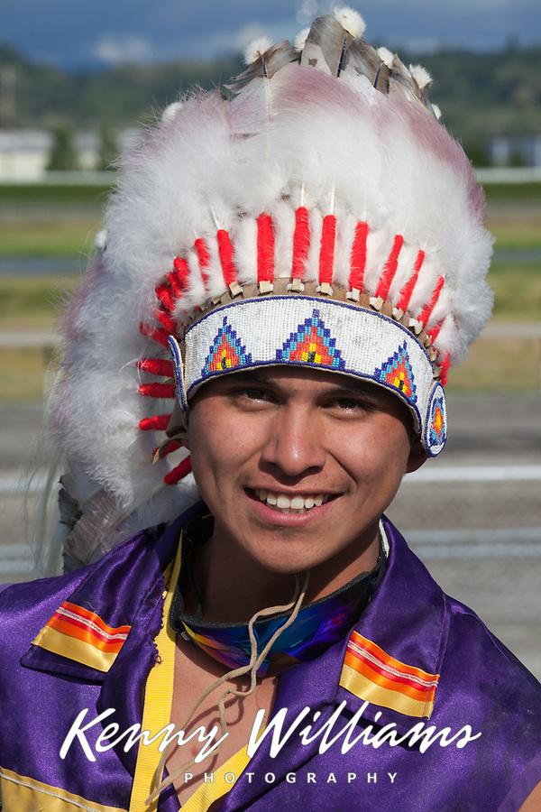 Native American Man wearing Feather Headdress, Auburn, Washington, USA.