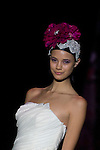 A model presents brides and party designs of Runway Miquel Suay at the Cibeles Madrid Novias in Ifema (Alterphotos/Marta Gonzalez)