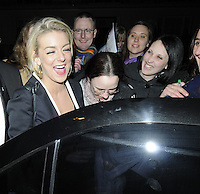 """SHERIDAN SMITH .Departed after the first preview performance of """"Flare Path"""", Haymarket, London, England, UK, 4th March 2011..portrait headshot fans smiling mouth open funny laughing   black  eyes shut .CAP/CAN.©Can Nguyen/Capital Pictures."""