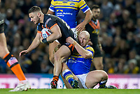 Picture by Allan McKenzie/SWpix.com - 23/03/2018 - Rugby League - Betfred Super League - Leeds Rhinos v Castleford Tigers - Elland Road, Leeds, England - Castleford's Jy Hitchcox is tackled by Leeds's Carl Ablett.