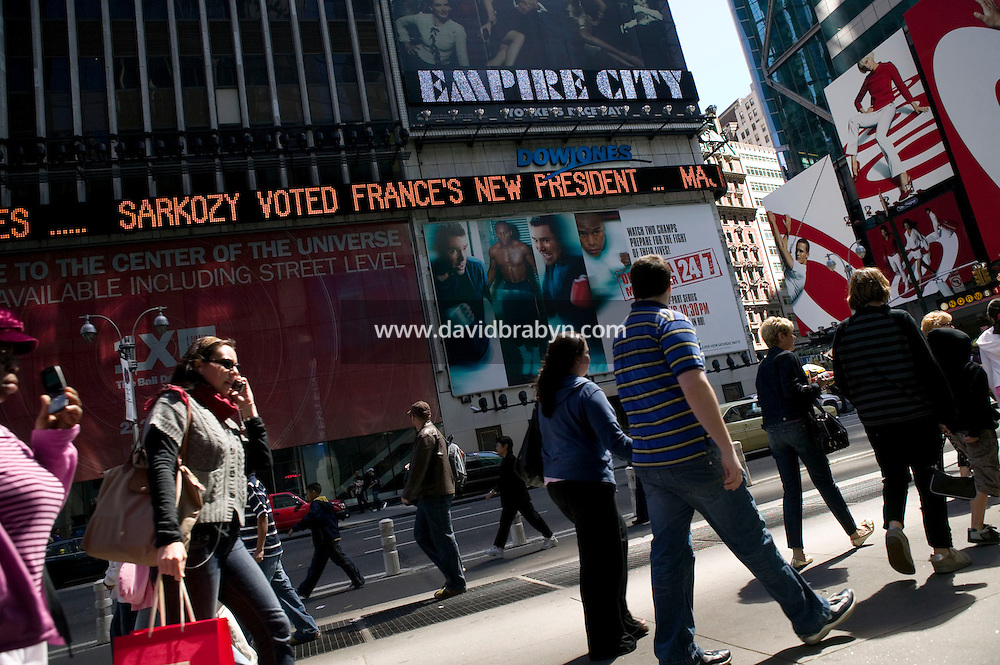 "6 May 2007 - New York City, NY - A message reading ""Sarkozy voted France's new president"" scrolls on the Dow Jones zipper in Times Square in New York City, USA, 22 April 2007, to announce Nicolas Sarkozy's victory in the French presidential elections."