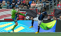 Foxborough, Massachusetts - July 7, 2018: First half action. In a Major League Soccer (MLS) match, New England Revolution (blue/white) vs Seattle Sounders FC (green), at Gillette Stadium.