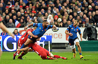 28.02.2015. Stade de France, Paris, France. 6 Nations International Rugby. France versus Wales.  Mathieu Bastareaud (fra) hands off as he is brought down by Welsh 7 Warburton